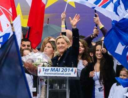 Far-right French party leader Le Pen joins demonstration